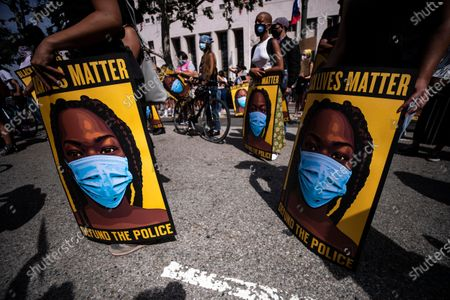 Protesters hold placards during a Black Lives Matter protest outside the Hall of Justice in Los Angeles, California, USA, 24 June 2020. The death of George Floyd while in Minneapolis police custody on 25 May has sparked global protests demanding justice and racial equality.