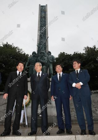 Kim Chong-in (2-L), the interim leader of the main opposition United Future Party, visits a monument to the Incheon Landing Operation in the 1950-53 Korean War, in Incheon, South Korea, 25 June 2020, as South Korea marked the 70th anniversary of the start of the 1950-53 conflict. The 1950 operation, commanded by US Gen. Douglas MacArthur, turned the tide of the war against the invading North Korea.