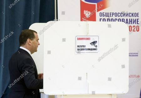Deputy chairman of the Russian Security Council Dmitry Medvedev fills his ballot in a booth during vote on amendments to Russian Constitution at a polling station in Moscow, Russia, 25 June 2020. The nationwide vote on amendments to the Russian Constitution has started on 25 June and will run for seven days till 1 July. The counting of the results for all seven days will begin on July 1 after the closing of polling stations. At first the vote was scheduled on 22 April but was postponed due to the situation with coronavirus COVID-19 pandemic.