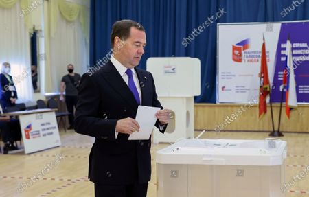 Deputy chairman of the Russian Security Council Dmitry Medvedev prepares to cast his ballot in a booth during vote on amendments to Russian Constitution at a polling station in Moscow, Russia, 25 June 2020. The nationwide vote on amendments to the Russian Constitution has started on 25 June and will run for seven days till 1 July. The counting of the results for all seven days will begin on July 1 after the closing of polling stations. At first the vote was scheduled on 22 April but was postponed due to the situation with coronavirus COVID-19 pandemic.