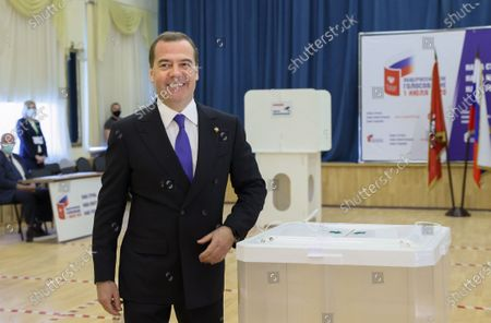 Stock Image of Deputy chairman of the Russian Security Council Dmitry Medvedev smiles after he casted his ballot in a booth during vote on amendments to Russian Constitution at a polling station in Moscow, Russia, 25 June 2020. The nationwide vote on amendments to the Russian Constitution has started on 25 June and will run for seven days till 1 July. The counting of the results for all seven days will begin on July 1 after the closing of polling stations. At first the vote was scheduled on 22 April but was postponed due to the situation with coronavirus COVID-19 pandemic.