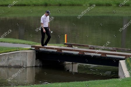 Jim Furyk walks on a bridge while heading to the 16th green during the first round of the Travelers Championship golf tournament at TPC River Highlands, in Cromwell, Conn