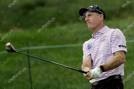 Jim Furyk watches his tee shot on the 17th hole during the first round of the Travelers Championship golf tournament at TPC River Highlands, in Cromwell, Conn
