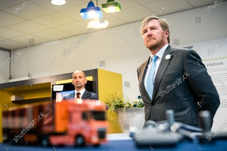 Stock Image of King Willem-Alexander makes a visit to the companies Nedschroef in Helmond and DAF Trucks in Eindhoven, in the context of the impact of the corona pandemic on the manufacturing industry, in particular the automotive industry.