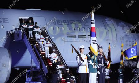 Stock Image of Honor guards carry caskets containing the remains of South Korean soldiers killed during the Korean War from an Air Force aerial tanker during a ceremony to mark the 70th anniversary of the outbreak of the 1950-53 conflict, at Seoul Air Base in Seongnam, south of Seoul, South Korea, 25 June 2020. The 1950 operation, commanded by US Gen. Douglas MacArthur, turned the tide of the war against the invading North Korea.