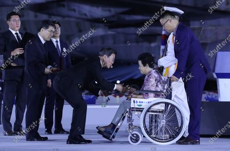 President Moon Jae-in (C) bestows the Order of Military Merit to a family member of a fallen Korean War soldier during a ceremony to mark the 70th anniversary of the outbreak of the 1950-53 Korean War, at Seoul Air Base in Seongnam, south of Seoul, South Korea, 25 June 2020. The 1950 operation, commanded by US Gen. Douglas MacArthur, turned the tide of the war against the invading North Korea.