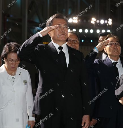 Stock Photo of President Moon Jae-in (C) salutes caskets containing the remains of South Korean soldiers killed during the Korean War during a ceremony to mark the 70th anniversary of the outbreak of the 1950-53 conflict, at Seoul Air Base in Seongnam, south of Seoul, South Korea, 25 June 2020. The 1950 operation, commanded by US Gen. Douglas MacArthur, turned the tide of the war against the invading North Korea.