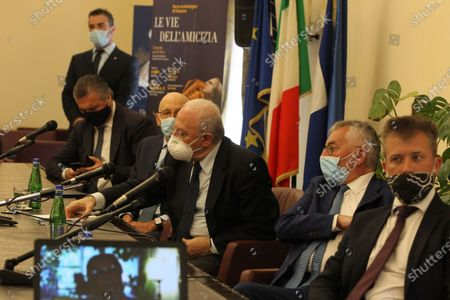 "Stock Picture of Press conference of the presentation of the concert ""Le vie dell'Amicizia-concerto per la Siria"" by Maestro Riccardo Muti. The demonstration on July 5 at the ruins of Paestum.In picture  in order L to R:Francesco Alfieri,mayor of Capaccio Paestum, Andrea Prete, Presidente della Camera di Commercio di Salerno,Vincenzo De Luca,governor of Regione Campania,Antonio De Rosa,Superintendent of the Ravenna Festival(Sovrintendente del Ravenna Festival),Gabriel Zuchtriegel, director of the Archaeological Park of Paestum."