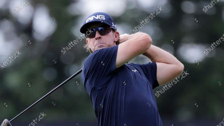 Stock Image of Hunter Mahan tees off on the sixth hole during the first round of the Travelers Championship golf tournament at TPC River Highlands, in Cromwell, Conn
