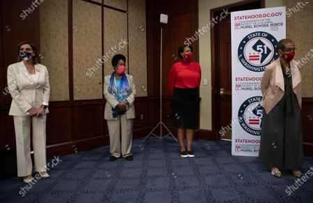 From left, House Speaker Nancy Pelosi of Calif., Rep. Sheila Jackson Lee, D-Texas, District of Columbia Mayor Muriel Bowser and Delegate Eleanor Holmes Norton, D-D.C., practice social distancing at news conference on Capitol Hill in Washington, about D.C. statehood