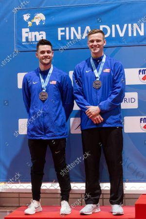 Stock Photo of US divers David Boudia (L) and Steele Jhonson (R) second placed celebrate on the podium after the men's 3 meters synchronized dive finals in the framework of the FINA Diving Grand Prix Madrid 2020 at M86 swimming pools in Madrid, Spain, 16 February 2020.