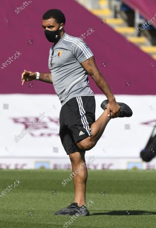 Troy Deeney of Watford wearing a protective face mask warms up ahead of the English Premier League soccer match between Burnley and Watford in Burnley, Britain, 25 June 2020.