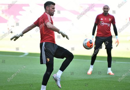 Watford goalkeeper Ben Foster (L) warms up ahead of the English Premier League soccer match between Burnley and Watford in Burnley, Britain, 25 June 2020.