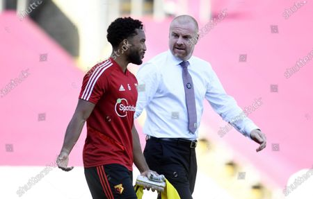 Burnley's manager Sean Dyche greets Adrian Mariappa of Watford (L) during the English Premier League match between Burnley and Watford in Burnley, Britain, 25 June 2020.