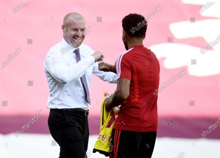 Burnley's manager Sean Dyche greets Adrian Mariappa of Watford (R) during the English Premier League match between Burnley and Watford in Burnley, Britain, 25 June 2020.