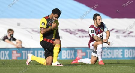 Troy Deeney of  Watford takes the knee during the English Premier League match between Burnley and Watford in Burnley, Britain, 25 June 2020.