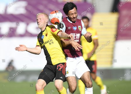 Dwight McNeil of Burnley (R) in action against Will Hughes of  Watford  (L) during the English Premier League match between Burnley and Watford in Burnley, Britain, 25 June 2020.