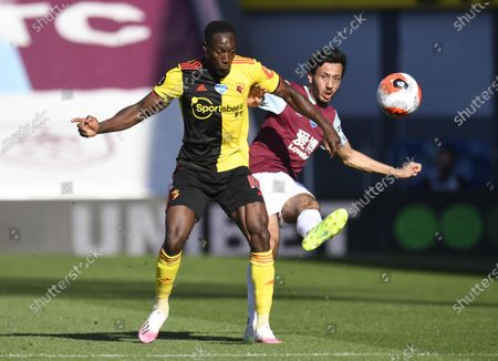 Dwight McNeil of Burnley (R) in action against Danny Welbeck of  Watford (L) during the English Premier League match between Burnley and Watford in Burnley, Britain, 25 June 2020.