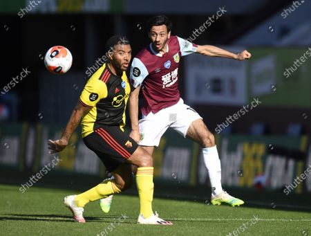 Dwight McNeil of Burnley (R) in action against Troy Deeney of  Watford (L) during the English Premier League match between Burnley and Watford in Burnley, Britain, 25 June 2020.