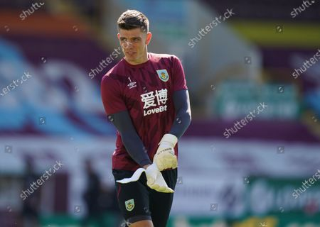 Burnley goalkeeper Nick Pope warms up ahead of the English Premier League soccer match between Burnley and Watford in Burnley, Britain, 25 June 2020.