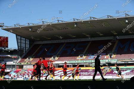 Watford players warm up ahead of the English Premier League match between Burnley and Watford in Burnley, Britain, 25 June 2020.