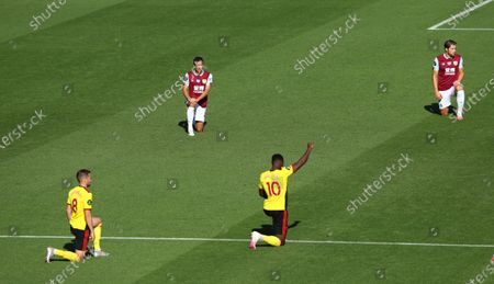 Danny Welbeck of Watford (C) takes the knee during the English Premier League match between Burnley and Watford in Burnley, Britain, 25 June 2020.
