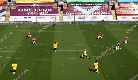 Burnley and Watford players take the knee during the English Premier League match between Burnley and Watford in Burnley, Britain, 25 June 2020.
