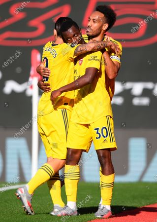 Arsenal's Eddie Nketiah (C) celebrates with teammates Dani Ceballos (L) and Pierre-Emerick Aubameyang (R) after scoring the 1-0 lead during the English Premier League soccer match between Southampton FC and Arsenal FC in Southampton, Britain, 25 June 2020.