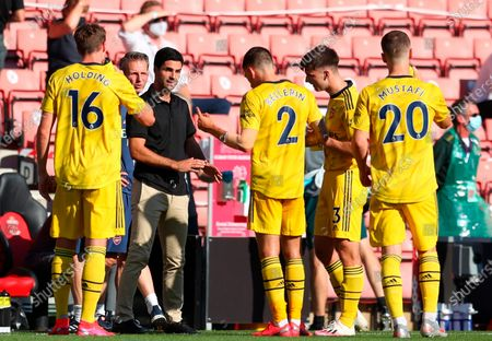 Arsenal manager Mikel Arteta (3-L) gives instructions to his players during the English Premier League soccer match between Southampton FC and Arsenal FC in Southampton, Britain, 25 June 2020.