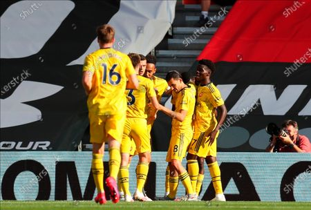 Arsenal players celebrate their 1-0 lead during the English Premier League soccer match between Southampton FC and Arsenal FC in Southampton, Britain, 25 June 2020.