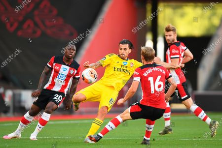 Arsenal's Dani Ceballos (C) in action against Southampton players Michael Obafemi (L) and James Ward-Prowse (R) during the English Premier League soccer match between Southampton FC and Arsenal FC in Southampton, Britain, 25 June 2020.