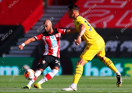 Southampton's Nathan Redmond (L) in action against Arsenal's Granit Xhaka (R) during the English Premier League soccer match between Southampton FC and Arsenal FC in Southampton, Britain, 25 June 2020.
