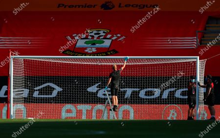 Ground staff disinfect the goal before the English Premier League soccer match between Southampton FC and Arsenal FC in Southampton, Britain, 25 June 2020.
