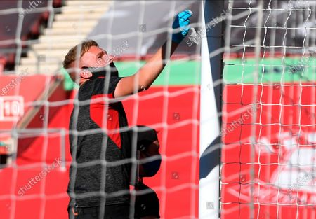 Ground staff disinfect the goal posts before the English Premier League soccer match between Southampton FC and Arsenal FC in Southampton, Britain, 25 June 2020.