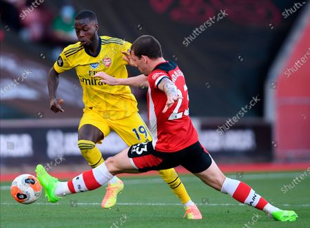 Arsenal's Nicolas Pepe (L) in action against Southampton's Pierre-Emile Hojbjerg (R) during the English Premier League soccer match between Southampton FC and Arsenal FC in Southampton, Britain, 25 June 2020.