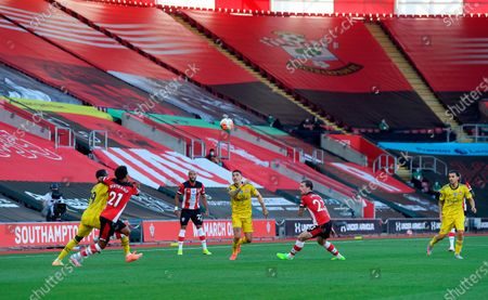 Players of Southampton (red) and Arsenal (yellow) in action in front of empty seats at the St Mary's Stadium during the English Premier League soccer match between Southampton FC and Arsenal FC in Southampton, Britain, 25 June 2020.