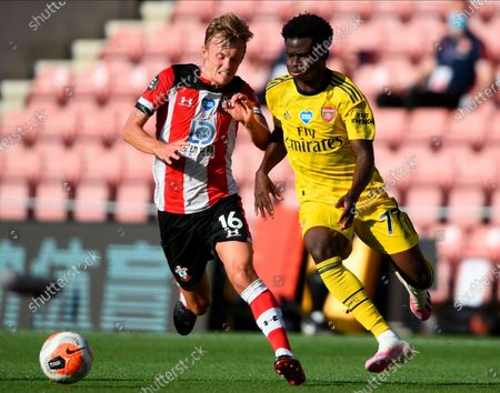 Arsenal's Bukayo Saka (R) in action against Southampton's James Ward-Prowse (L) during the English Premier League soccer match between Southampton FC and Arsenal FC in Southampton, Britain, 25 June 2020.