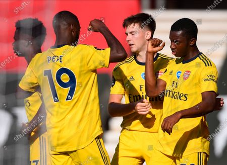 Arsenal's Eddie Nketiah (R) celebrates with teammate Nicolas Pepe (L) after scoring the 1-0 lead during the English Premier League soccer match between Southampton FC and Arsenal FC in Southampton, Britain, 25 June 2020.
