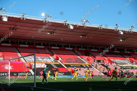Players of Southampton (red) and Arsenal (yellow) in action in front of empty stands during the English Premier League soccer match between Southampton FC and Arsenal FC in Southampton, Britain, 25 June 2020.
