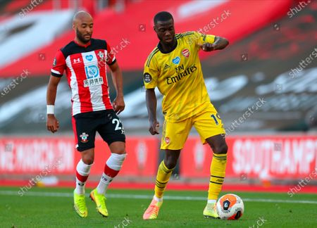 Arsenal's Nicolas Pepe (R) in action against Southampton's Nathan Redmond (L) during the English Premier League soccer match between Southampton FC and Arsenal FC in Southampton, Britain, 25 June 2020.