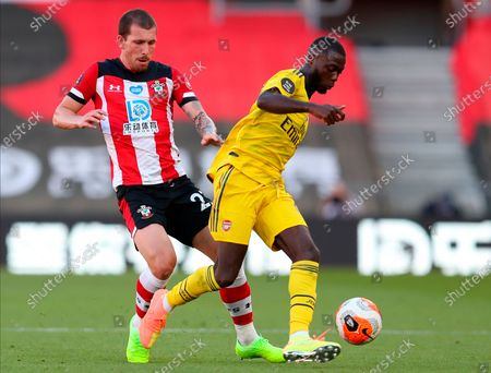 Arsenal's Nicolas Pepe (R) in action against Southampton's Pierre-Emile Hojbjerg (L) during the English Premier League soccer match between Southampton FC and Arsenal FC in Southampton, Britain, 25 June 2020.