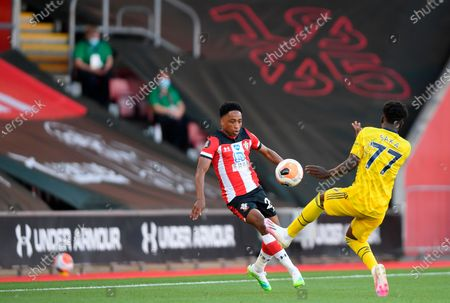 Southampton's Kyle Walker-Peters (L) in action against Arsenal's Bukayo Saka (R) during the English Premier League soccer match between Southampton FC and Arsenal FC in Southampton, Britain, 25 June 2020.