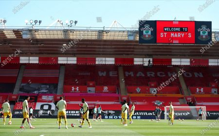 Arsenal players warm up for the English Premier League soccer match between Southampton FC and Arsenal FC in Southampton, Britain, 25 June 2020.