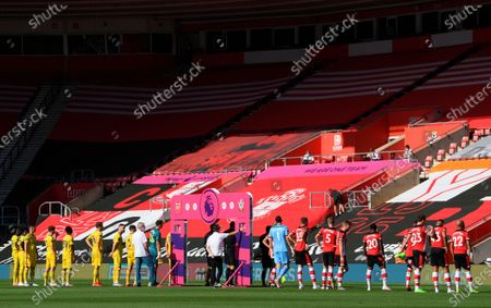 Players of Southampton (R) and Arsenal (L) line up for the English Premier League soccer match between Southampton FC and Arsenal FC in Southampton, Britain, 25 June 2020.