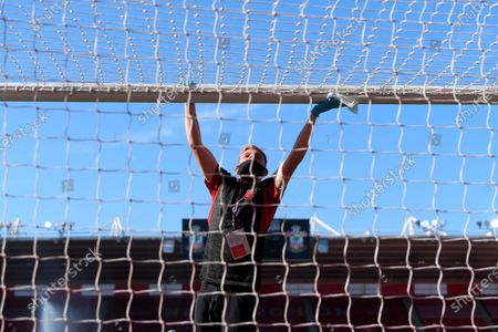 Ground staff disinfect the goal bar before the English Premier League match between Southampton FC and Arsenal FC in Southampton, Britain, 25 June 2020.