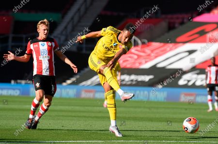 Arsenal's Pierre-Emerick Aubameyang (R) in action against Southampton's James Ward-Prowse (L) during the English Premier League soccer match between Southampton FC and Arsenal FC in Southampton, Britain, 25 June 2020.