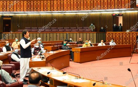 """In this photo released by the Press Information Department, Pakistani Prime Minister addresses the Parliament in Islamabad, Pakistan, . Khan accused the United States on Thursday of having """"martyred"""" al-Qaida leader and the mastermind of the 9/11 attacks, Osama bin Laden"""