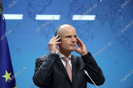 Dutch Foreign Affairs Minister Stef Blok adjusts his headphones for simultaneous interpretation as he takes part in a joint press conference with his Spanish counterpart, Arancha Gonzalez Laya (not pictured), after their bilateral meeting in Madrid, Spain, 25 June 2020.