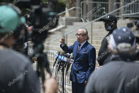 Attorney Sanford Rubenstein addresses the media outside the Queens courthouse following with the arraignment of Police Officer David Afanador, in New York. Afanador pleaded not guilty on Thursday to charges of strangulation and attempted strangulation over an altercation last weekend on the Rockaway Beach boardwalk. Video shows Afanador with his arm wrapped around a man's neck for several seconds during an arrest