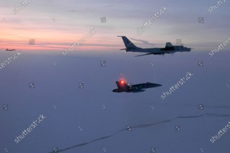 Released by the North American Aerospace Defense Command (NORAD), a Russian Tu-142 maritime reconnaissance aircraft, top right, is intercepted near the Alaska coastline. Two Russian aircraft that came within 50 miles (80 kilometers) of Unimak Island along Alaska's Aleutian chain were intercepted late Wednesday, June 24, 2020, military officials said Thursday. The incident marked the fifth time this month that such an intercept has taken place, Gen. Terrence J. O'Shaughnessy, commander of the North American Aerospace Defense Command, said in a release
